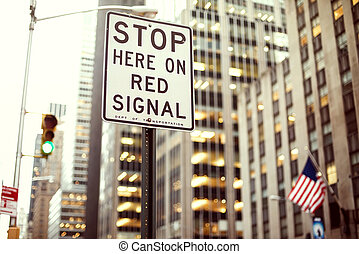 Stop here on red signal Sign on Manhattan