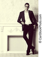 sepia fashion - Vogue shot of a handsome elegant man in a...