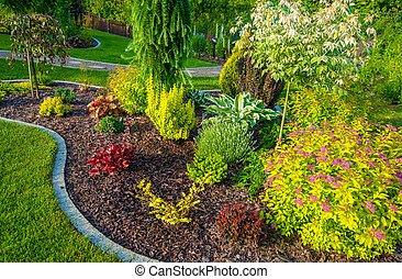 New Garden Design. Small Backyard Garden Closeup Photo.