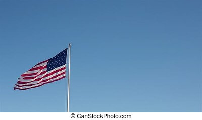 American Flag Windy Day - An American flag waving on a windy...