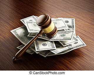 Judge gavel on 100 dollar paper money pile.