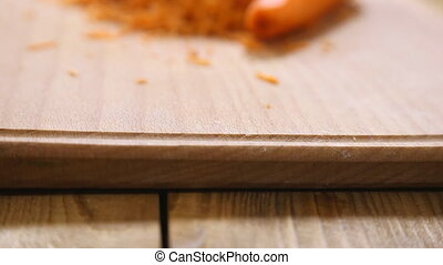 grated carrots on a wooden board closeup