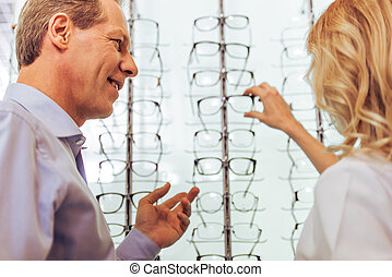 At the ophthalmologist - Handsome middle aged man at the...