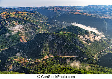 Montenegro mountain roads - aerial - Road and small mountain...