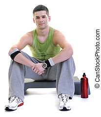 sportsman relaxing and drinking water - young adult man...