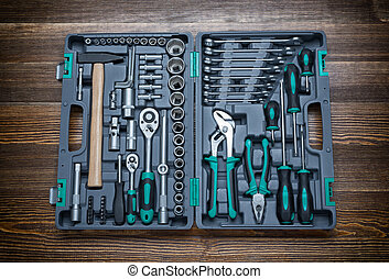 Open toolbox with different instruments on wooden workbench...