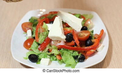 Fresh salad with olive oil isolated on white background, pouring salad dressing into cutting vegetables, organic food, healthy nutrition concept.