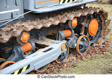 caterpillar tractor wheel with orange pattern