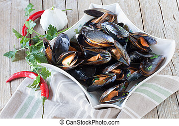Sauteed Mussels - Plate with sauteed mussels decorated with...