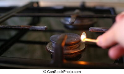 Gas Stove Burner Lighting Close Up Center. a close up shot of a gas burner on a stove being lit. audio included