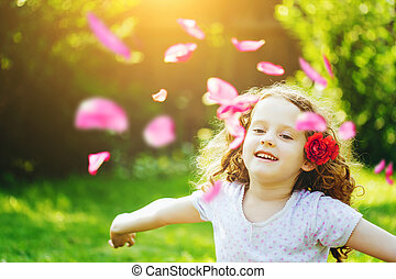 Happy child hand up, enjoying freedom with flying flower...