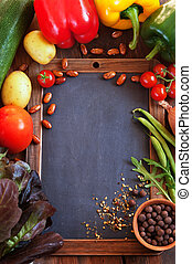 Restaurant menu - Food vegetables background with black desk...