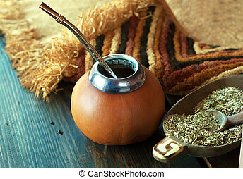 Yerba mate-South American tea, dried leaves in wooden bowl...