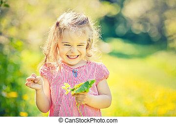 Happy little girl in spring sunny park - Happy little girl...