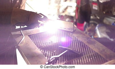 Welding then clean up of weld - Man welding then clean up of...