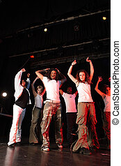 Dancers on stage - A group of six female and male freestyle...
