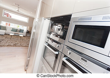 Closeup of modern ovens and a refrigerator in the luxurious...