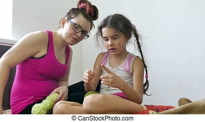woman and tgirl lknitting - woman and teen girl lifestyle...