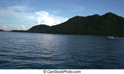 River trip on Phuket island. - High hill with green trees...