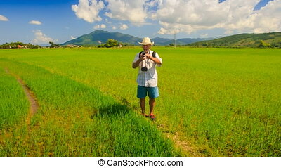 Old Man in Hat Makes Selfie against Rice Field by Hills -...