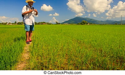 Old Man in Hat Sets Camera Photos Rice Field against Hills -...