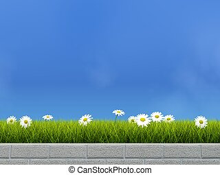 Flower bed with grass and camoline over blue sky background