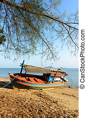 Fishing boat aground on the beach