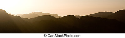 Sun setting over a mountain range - Panorama of the sun...