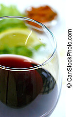 Wine and dinner - Close up shot of wine glass with dinner on...