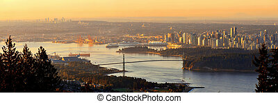 Vancouver sunrise with Lions Gate Bridge and skyscrapers in...