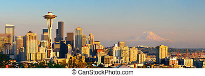 Seattle city skyline with Mt Rainier at sunset with urban...