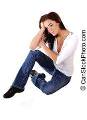 Sad girl sitting on floor.
