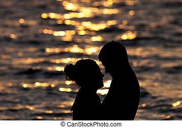 silhouette of two people in love at sunrise