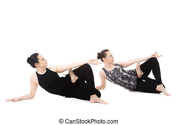Two Yogi female relax in Yogadandasana - Sporty yogi female...