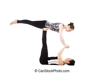 Two Yogi female partners doing yoga exercises - Athlete...