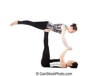 Two Yogi female partners doing yoga exercises - Athlete...