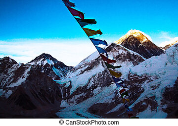 Everest from Kalapathar tops lighting evening sun with Buddhist prayer flags