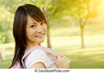 Young Asian college girl student smiling