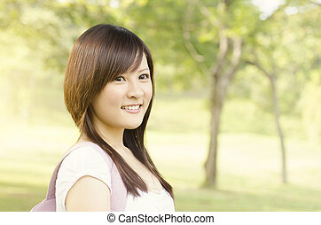 Young Asian girl student smiling