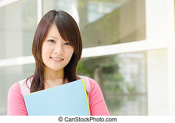 Young Asian college student at school campus