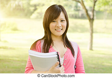 Young Asian university girl student