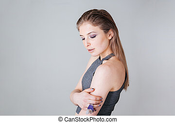 Beauty portrait of attractive woman standing over gray...