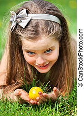 Child search easter egg outdoor - Little girl look up is...