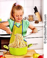 Children cooking at kitchen. - Child girl preparing...