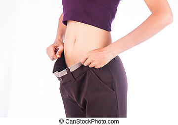 Slim waist of beauty woman in big trousers,after weight...
