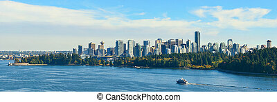 Vancouver city skyline panorama and mountains.