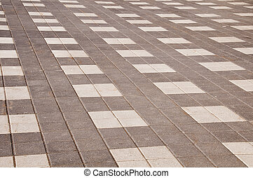Interlock brick in grey and white colours with brown sand...