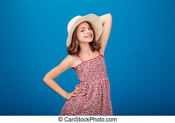 Portrait of beautiful smiling little girl in hat and...