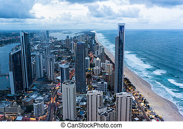 Gold Coast at dusk - City by the beach at dusk, aerial, view...