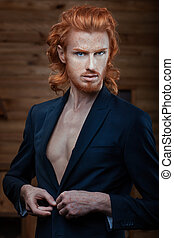 Man with the fiery hair - The man wears a jacket over his...
